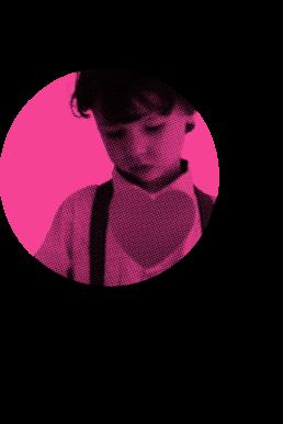 A boy holding a heart shape