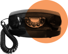 An analogue phone with an orange circle over it